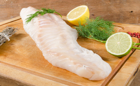 Cod fillet on wooden board