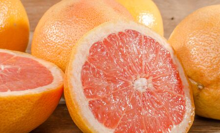 grapefruits: Fresh grapefruits on wooden background Stock Photo