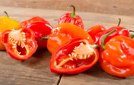 habanero: Fresh habanero peppers on wooden background