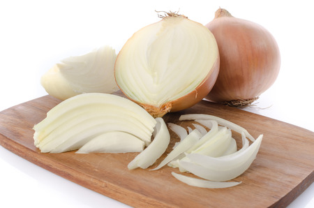 isolated on yellow: Whole and sliced onions on a cutting board, isolated on white Stock Photo