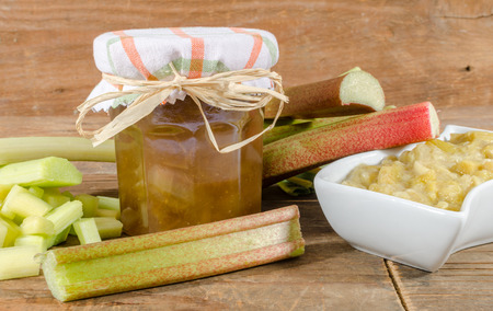 rhubarb: Composition with different preparations of rhubarb on wooden background