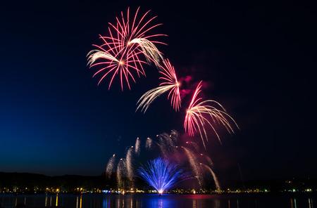 Beautiful fireworks show on a lake Stok Fotoğraf