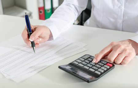working woman: Woman accountant working on financial results Stock Photo