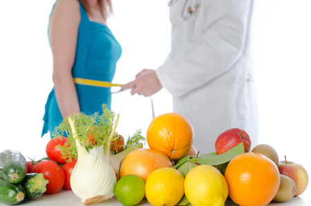 Doctor nutritionist in office measuring the waist of a patient Stok Fotoğraf