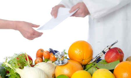 dietetics: Doctor nutritionist in office giving a diet plan to his patient
