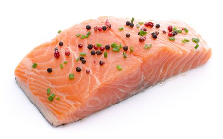 spice isolated: Fresh raw salmon fillet with spice, isolated on white