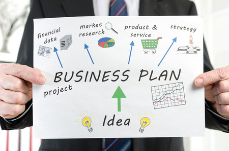 businessplan: Businessman showing business plan concept at office Stock Photo