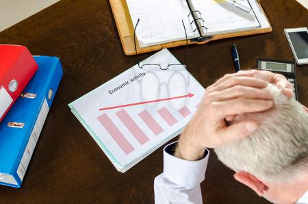despairing: Despairing businessman because of the economic crisis