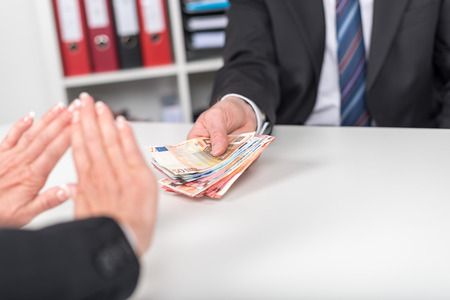 Woman refusing to take bribe Stock Photo