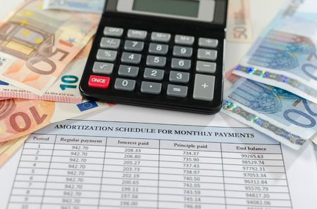 amortization: Banknotes, calculator and amortization schedule Stock Photo