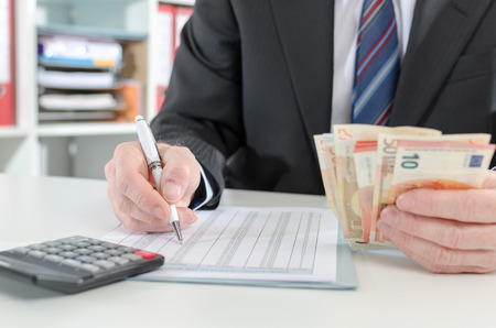 Businessman making investment calculations