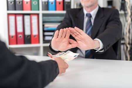 refusing: Businessman refusing to take bribe