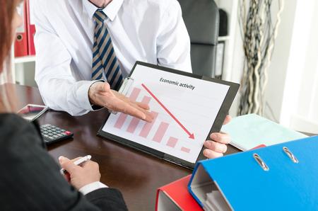 falling down: Businessman showing graph falling down Stock Photo