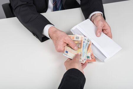 cash money: Businessman giving cash money to a person