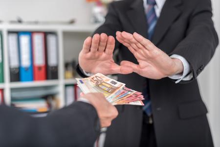 Businessman refusing to take bribe