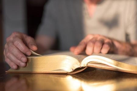 dim light: Man reading the Bible in dim light