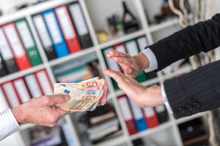 rejecting: Woman hands rejecting an offer of money