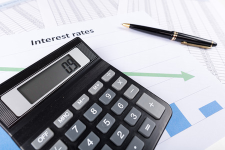 rates: Interest rates documents with calculator Stock Photo
