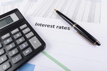Interest rates documents with calculator Foto de archivo