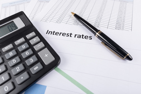 Interest rates documents with calculator Standard-Bild