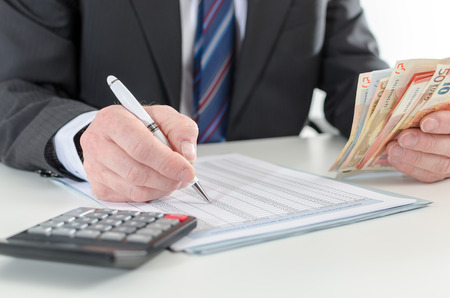 calculations: Businessman making investment calculations