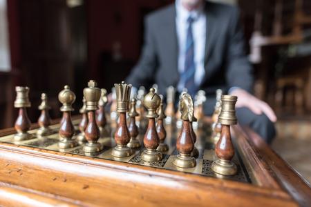 pensamiento estrategico: Businessman thinking about strategic move, strategy concept Foto de archivo
