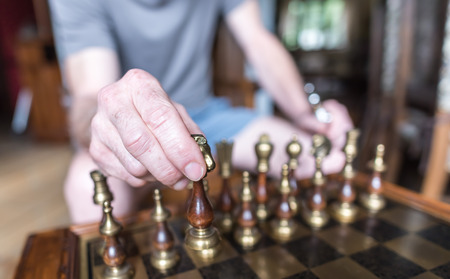 chess move: Player moving a chess piece Stock Photo