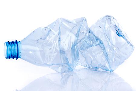 Crushed plastic bottle, isolated on white 스톡 콘텐츠