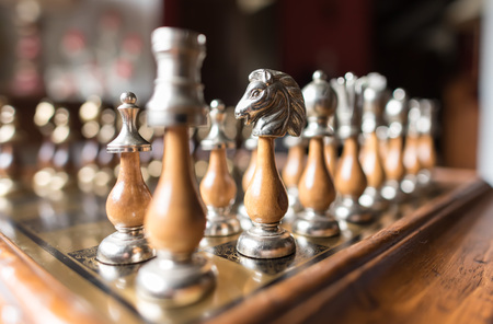 chess pawn: Aligned chess pieces on a chessboard Stock Photo