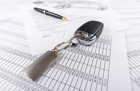 signed: Car keys on the signed agreement document Stock Photo