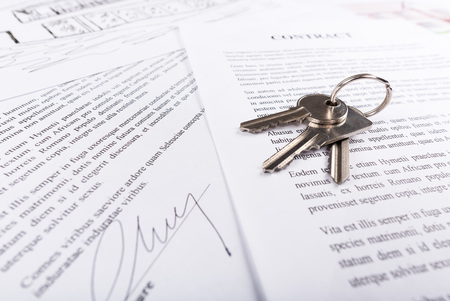 Real estate contract with keys (random latin dummy text used)