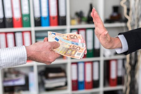 rejecting: Woman hand rejecting an offer of money