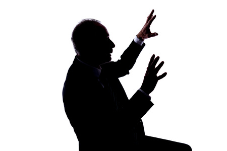 expressing: Silhouette of a man expressing the fright