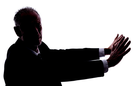 abhorrence: Silhouette of a man expressing disgust Stock Photo