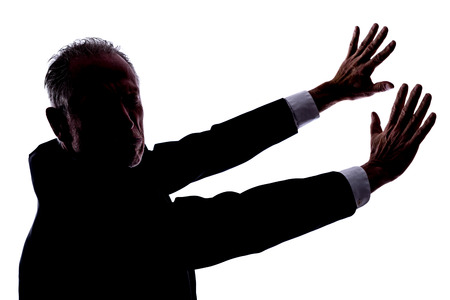 revulsion: Silhouette of a man expressing disgust Stock Photo