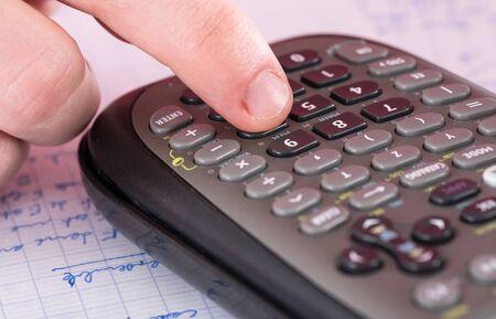 algebra calculator: Finger typing on a scientific calculator, closeup Stock Photo