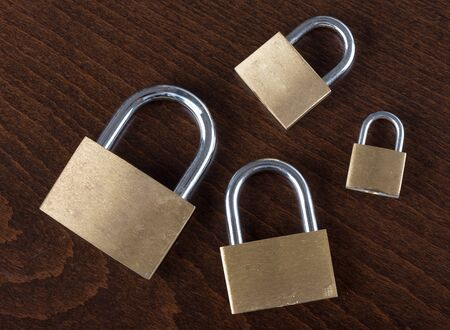 safeguards: Padlocks on wooden background
