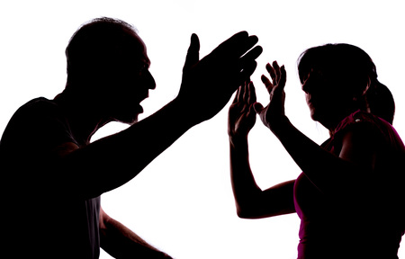 Silhouette showing domestic violence 스톡 콘텐츠
