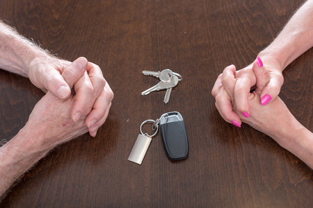 breakup: Concept of separation of a couple with house and car keys