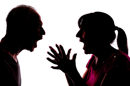 Silhouette of couple having conflict Stock Photo