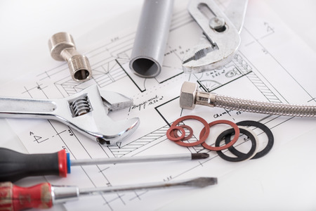 plumbing tools: Set of plumbing materials on a plan