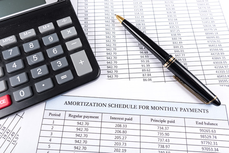 amortization: Amortization schedule documents with calculator