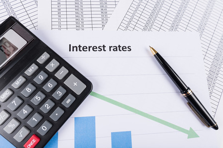Interest rates documents with calculator Stock Photo