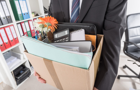 unemployed dismissed: Businessman fired, leaving his office with his personal effects Stock Photo