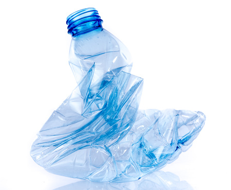 Crushed plastic bottle, isolated on white Banco de Imagens