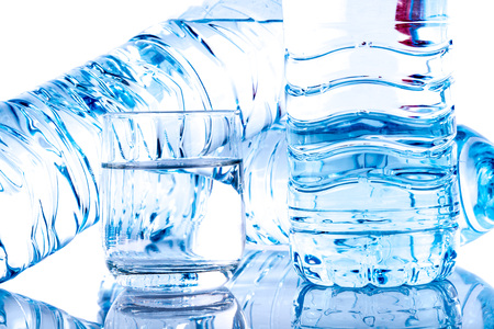 water bottles: Plastic water bottles with a glass, isolated on white