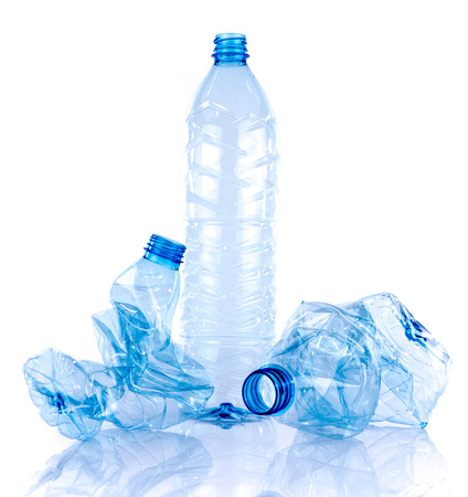 Whole and crushed plastic bottles, isolated on white Stok Fotoğraf