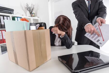 unemployed dismissed: Upset businesswoman fired because of bad results Stock Photo