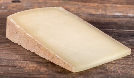 French Comte cheese county, on wooden background Standard-Bild