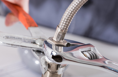 screwing: Screwing plumbing fittings, closeup Stock Photo